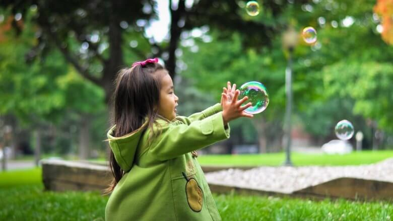Girl bursting bubbles