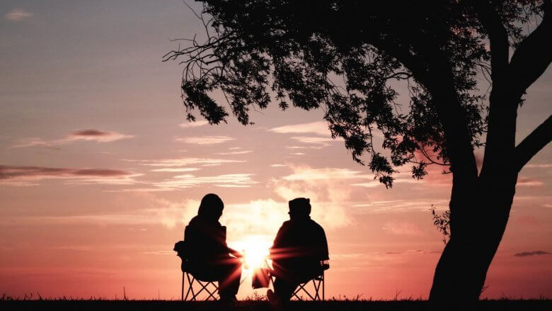 Couple staring at sunset